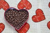 foto of decoupage  - Heart shaped box filled with small chocolates balls on the hearth decorated table  - JPG
