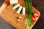 stock photo of pita  - pita bread with green onion and tomato on a wooden table - JPG