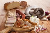 image of grease  - Blood sausage rice sausage head cheese garlic onion beer and bread on wooden kitchen board on wooden background - JPG