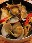 stock photo of clam  - herbal clam soup Vietnam style close up - JPG