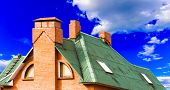 foto of chimney  - chimney on the roof of the house against the blue sky - JPG