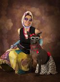 foto of rockabilly  - Pinup and Rockabilly styled woman with a dog - JPG
