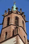 image of church  - An old church tower of a Catholic church against a blue sky  - JPG
