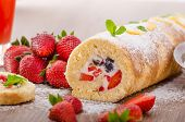 picture of sprinkling  - Sponge roll with strawberries and blueberries all fresh fruit sprinkled suger with mint leafes - JPG