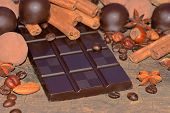pic of truffle  - Dark chocolate and truffles on a wooden surface - JPG