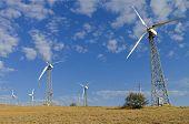 foto of generator  - Wind power generators against the blue sky - JPG