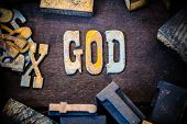 pic of supernatural  - The word GOD written in rusted metal letters surrounded by vintage wooden and metal letterpress type.