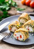image of curd  - Omelette rolls with curd and herbs on a plate - JPG