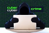 picture of hack  - hacker man in black hood and mask with computer laptop in dangerous dark look hacking system having access to data info and privacy in business digital intruder and cyber crime concept - JPG