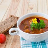picture of boeuf  - beef in a goulash stew served on the table - JPG