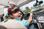 foto of panic  - Woman in panic behind the wheel of the car - JPG