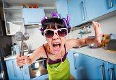 image of hysterics  - Crazy housewife in an interior of the kitchen - JPG