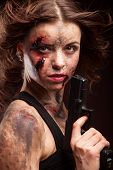 stock photo of girls guns  - Beautiful sexy girl with gun. Posing in studio. With blood on face and wound.
