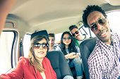 image of driving  - Group of five people driving to vacation and taking a selfie in the car - Happy people of of diverse ethnics in an automobile - Frinds renting a car and driving somewhere