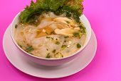 stock photo of glass noodles  - Glass noodle soup with chicken and beansprouts on a pink background - JPG