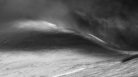 image of dapple-grey  - Beautiful dappled morning Winter sunlight on mountain landscape black and white - JPG