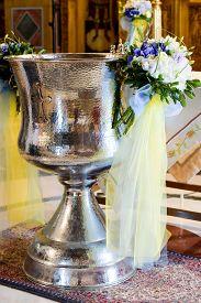 stock photo of baptism  - Orthodox Baptism Bowl prepared for christening ceremony in greek church - JPG