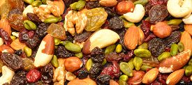 foto of brazil nut  - Mixed fruit and nut background with hazel and brazil nuts - JPG