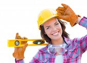 Young Attractive Female Construction Worker with Level Wearing Gloves, Hard Hat and Protective Goggl poster