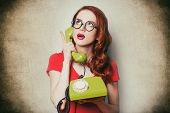 Beautiful Surprised Young Woman With Retro Phone poster