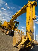 foto of heavy equipment operator  - Heavy Duty Construction Equipment Parked at Worksite - JPG