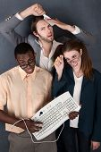 picture of bifocals  - Geeks with keyboard salesman comb and pencil making faces - JPG