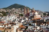 stock photo of taxco  - Taxco houses and beautiful church in Taxco Mexico - JPG