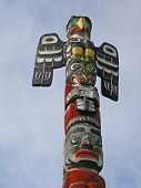 image of indian totem pole  - Detail Totem pole carved from cedar Thunderbird Park Victoria BC Canada - JPG