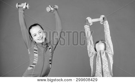 poster of Spending Hours At Gym. Cute Sisters Doing Gym Fitness Exercises With Dumbbells. Sport And Fitness Fo