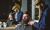Hipster With Beard Covered With Cape Trimming By Professional Barber In Stylish Barbershop. Barber B poster