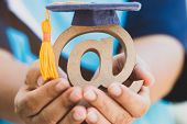 Education University Of Online Learning In Abroad Educational Concept: Graduation Cap On Email Addre poster
