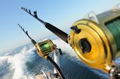 stock photo of troll  - big game fishing reels and rods somewhere in adriatic