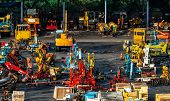 Heavy Machinery Second Hand Market. Crane, Forklift, Backhoe, And Electric Generator On Dirty Concre poster