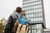 A Tourist With A Backpack Or A Guy Arrived To Check Into Apartments Or Watch Sights In A Big City Or poster