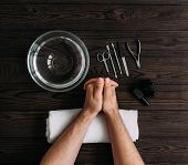 Mans Manicure. Mens Hands Prepared To Manicure. Nail Care Of The Hands. Mens Hands On Wooden Back poster