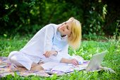 Woman With Laptop Or Notebook Sit On Rug Green Grass Meadow. Online Business Ideas Concept. Business poster