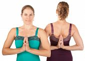 picture of namaskar  - Two Caucasian yoga women in Namaskar posture - JPG