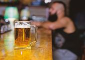 Weekend Lifestyle. Beer Mug On Bar Counter Defocused Background. Glass With Fresh Lager Draft Beer W poster