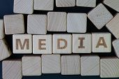 Media, Social Media Press And News Concept, Cube Wooden Block With Alphabet Combine The Word Media O poster