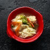 Pork Wonton Dumpling Soup With Vegetables In Bowl. poster