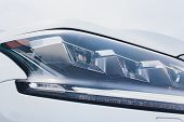 Close Up Of Headlight Detail Of Modern Luxury Car With Projector Lens For Low And High Beam. Front V poster