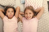 Best Friends Forever. Girls Children Lay On Bed With Cute Pillows Top View. Pajamas Party Concept. G poster