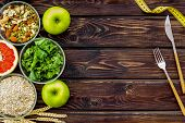Weight Loss Concept With Oatmeal, Nuts, Greenery, Fruits And Measuring Tape On Wooden Background Top poster
