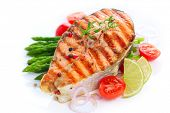picture of plate fish food  - grilled salmon with asparagus and cherry tomatoes on white plate - JPG