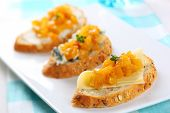 sandwich with variety of cheese and mango chutney, soft focus