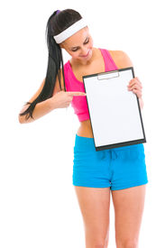 picture of athletic woman  - Slim girl pointing on blank clipboard isolated on white - JPG