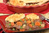 picture of biscuits gravy  - Beef stew with bicuits peas carrots and potatoes - JPG