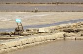 stock photo of marsala  - Directional sign in the middle of old salterns - JPG