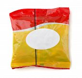 Red and yellow food packet with white label isolated on white