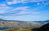 stock photo of semi-arid  - A view of the Okanagan Valley featuring the resort town of Osoyoos and surrounding orchards and vineyards - JPG